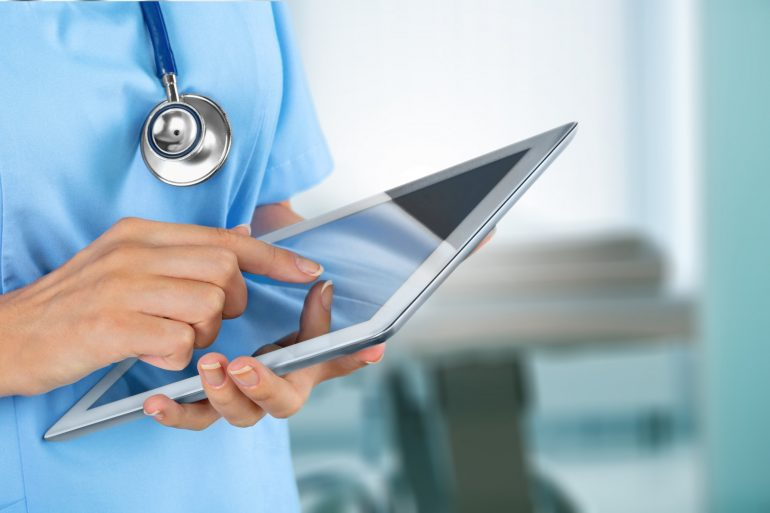 Doctor at hospital working with tablet